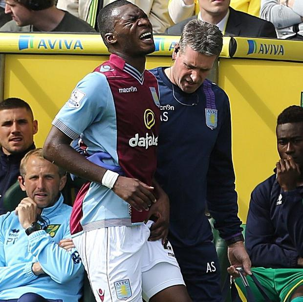 Christian Benteke, left, was forced off early at Carrow Road on Saturday