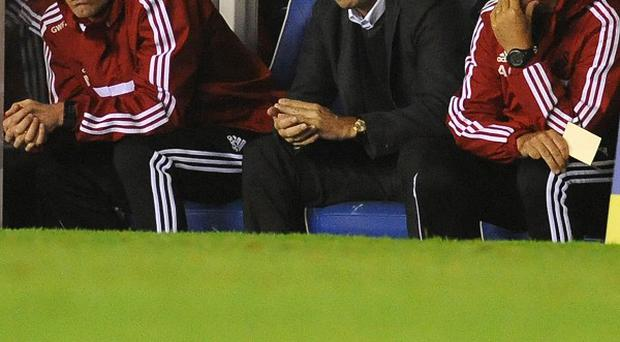 Michael Laudrup, centre, hopes Swansea bounce back from Wednesday's defeat with a performance against Arsenal