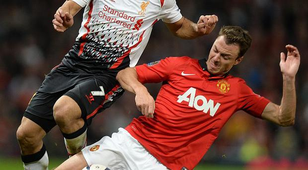 Jonny Evans, right, played his part in Manchester United's win over Liverpool