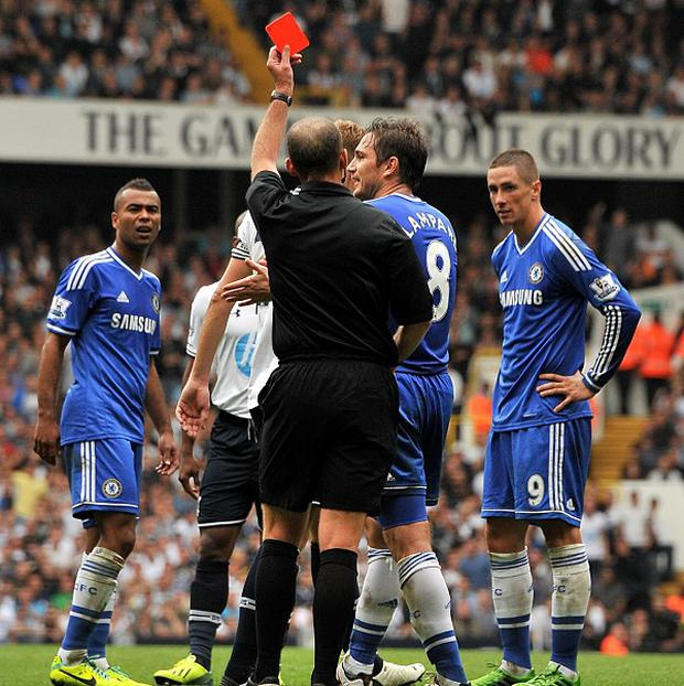 Fernando Torres, right, is sent off for an incident involving Jan Vertonghen