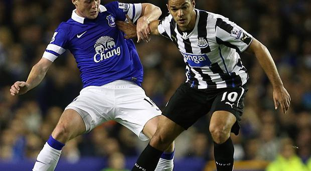 James McCarthy, left, knows he has to work hard to nail down a regular starting spot for Everton