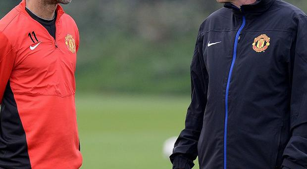 Ryan Giggs, left, insists the players must do more for David Moyes