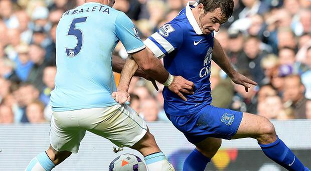Leighton Baines, right, believes Everton's midfield is very strong