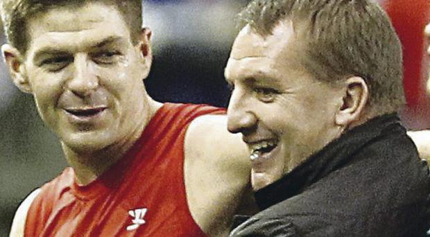 Captain fantastic: Brendan Rodgers shares a joke with Steven Gerrard, who he called a 'wonderful ambassador'