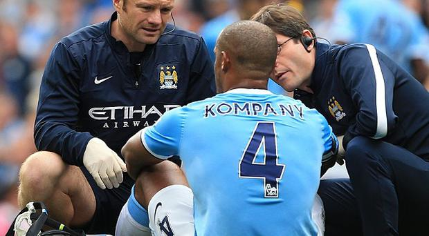 Vincent Kompany, centre, picked up his thigh injury against Everton a fortnight ago