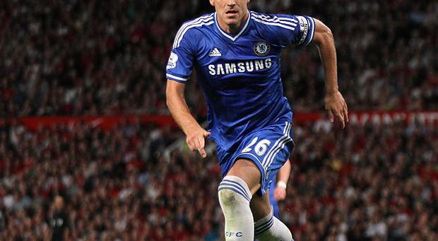 John Terry, pictured, is keeping England centre-back Gary Cahill out of the Chelsea team at present