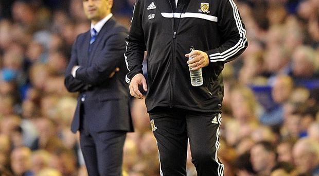 Steve Bruce, right, and Roberto Martinez, left, disagreed over challenges made by Gareth Barry