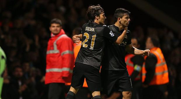 Sergio Aguero, right, wants City to build on their victory over West Ham
