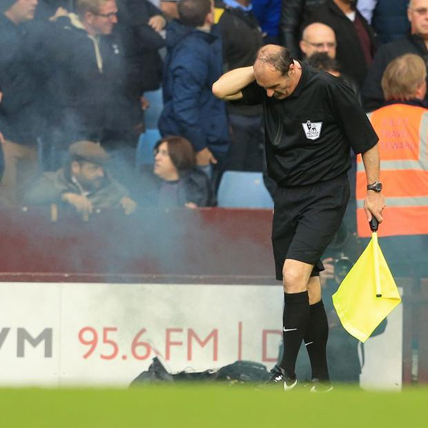 David Bryan was hit by a flare or smoke bomb during Aston Villa's match against Tottenham