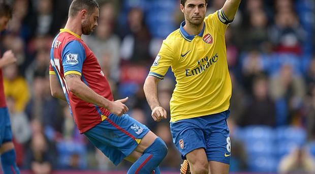 Mikel Arteta, right, celebrates netting the opener from the penalty spot