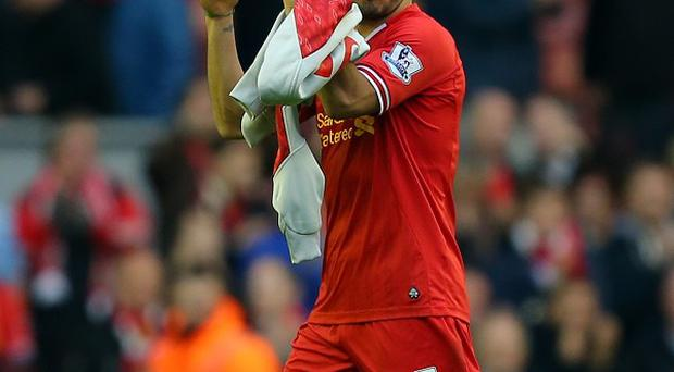 Luis Suarez scored his first home hat-trick for Liverpool