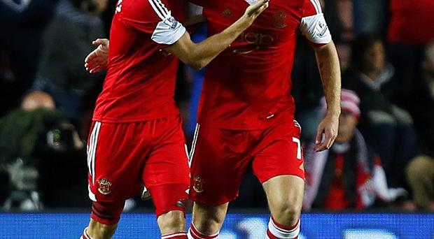 Jay Rodriguez, left, and Rickie Lambert, right, got Southampton's goals against Fulham on Saturday