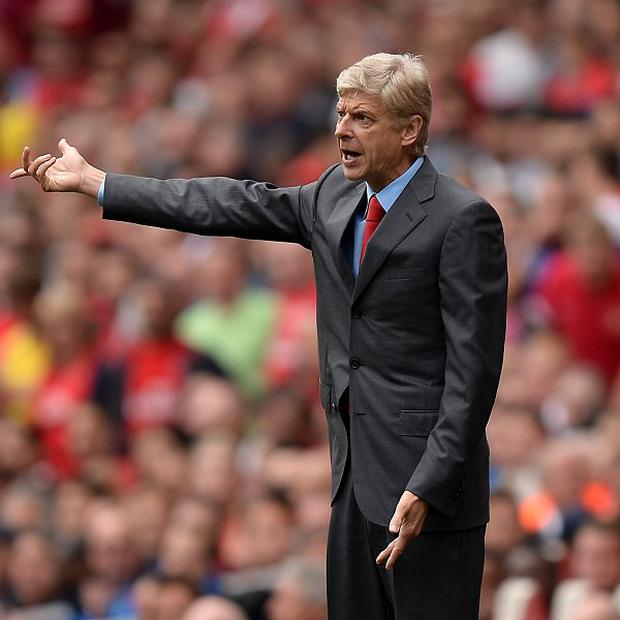 Arsene Wenger's Arsenal kept their cool to claim a 2-0 victory at Crystal Palace on Saturday