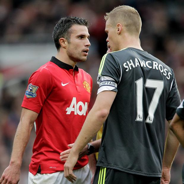 Ryan Shawcross, right, and Robin van Persie, left, clashed at the weekend