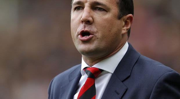 Malky Mackay's Cardiff face their fierce rivals Swansea on Sunday