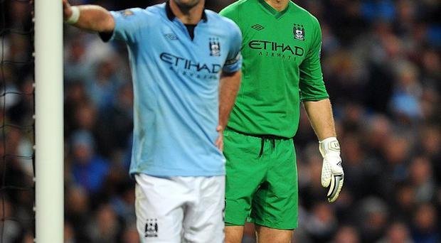 Joe Hart, right, was dropped to the bench against Norwich this weekend