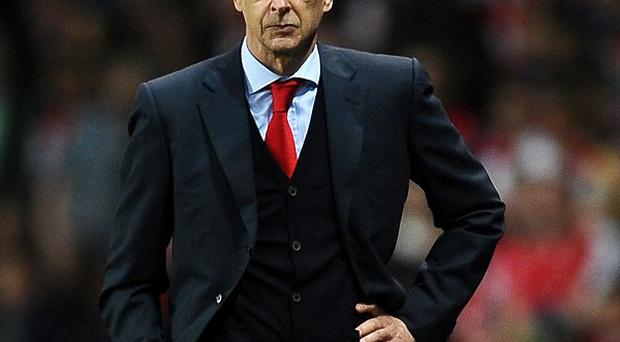 Arsene Wenger thinks his Arsenal side are beginning to believe Premier League glory is possible