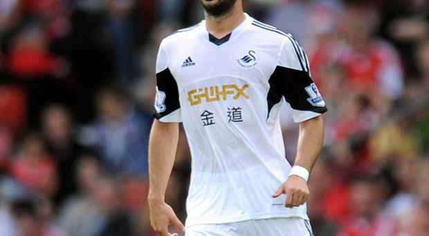 Jordi Amat is keen for an extended run in the Swansea team