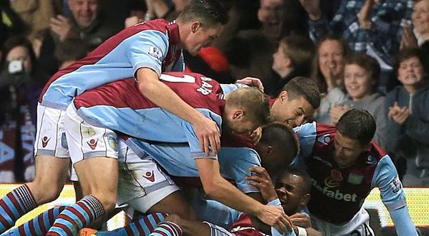 Leandro Bacuna, bottom, celebrates scoring Villa's first goal