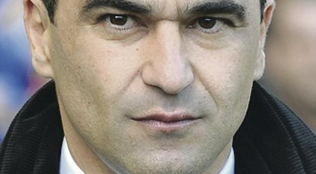 Focused: Roberto Martinez is concentrating on his own side