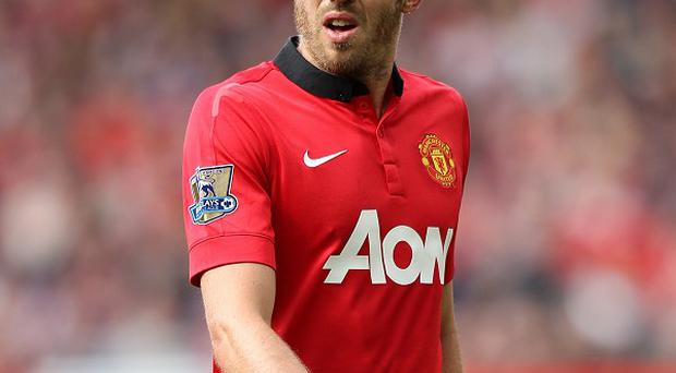 Michael Carrick has extended his Manchester United contract until 2015