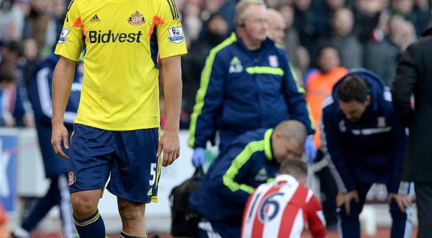 Wes Brown leaves the pitch after being sent off