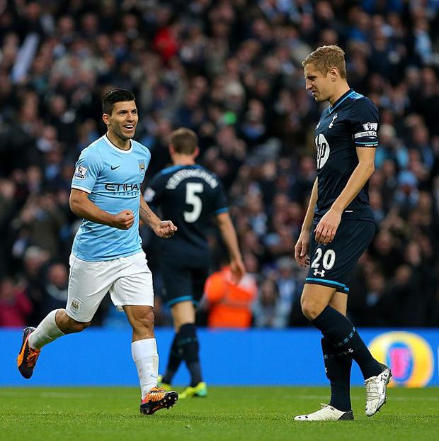 Sergio Aguero, centre, celebrates scoring his team's fourth goal