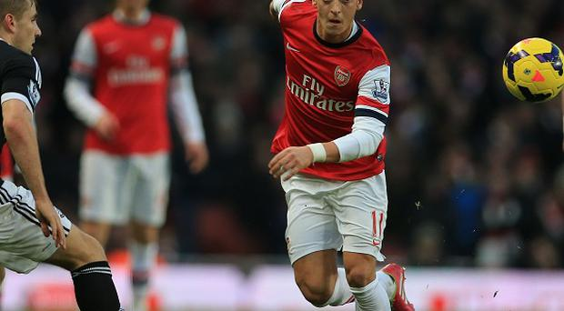 Arsene Wenger believes there is more to come from Mesut Ozil, centre.