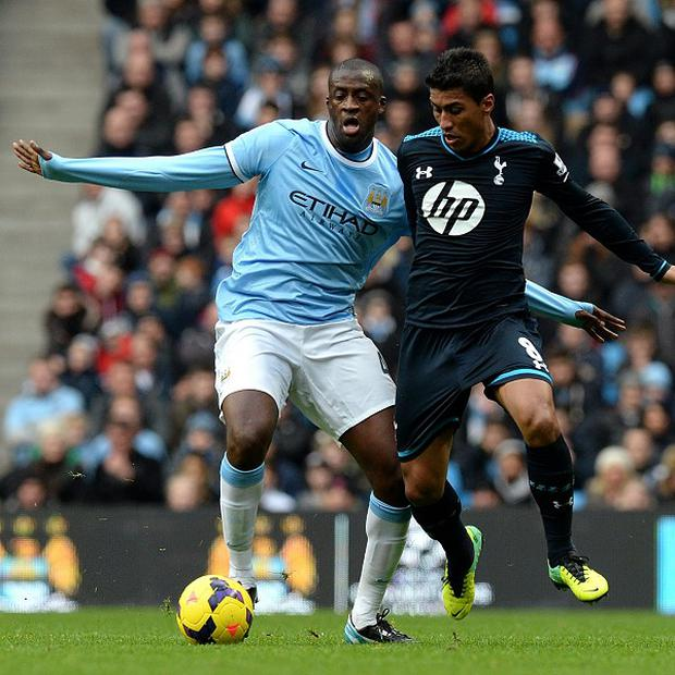 Yaya Toure, left, helped City to victory over Tottenham