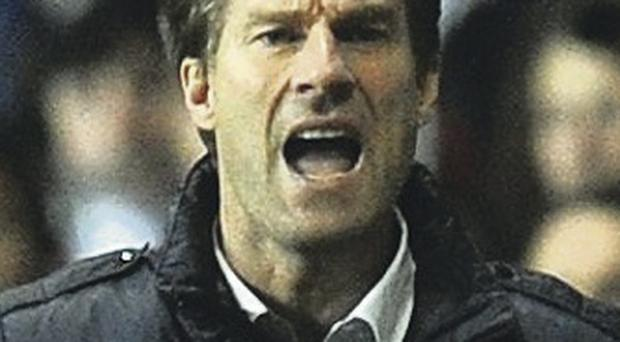 Giving the orders: Swansea boss Michael Laudrup last night