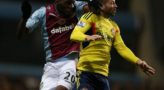 Christian Benteke, left, and Phil Bardsley challenge for the ball during the stalemate