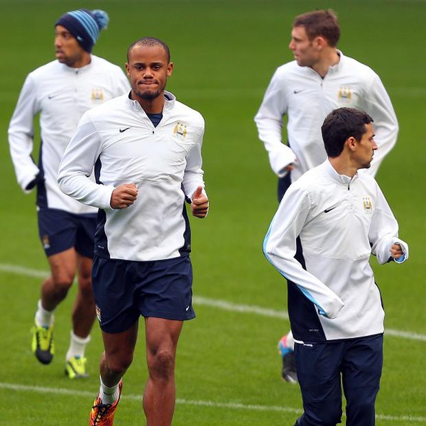 Vincent Kompany, centre, is raring to go for Man City having returned to training following injury