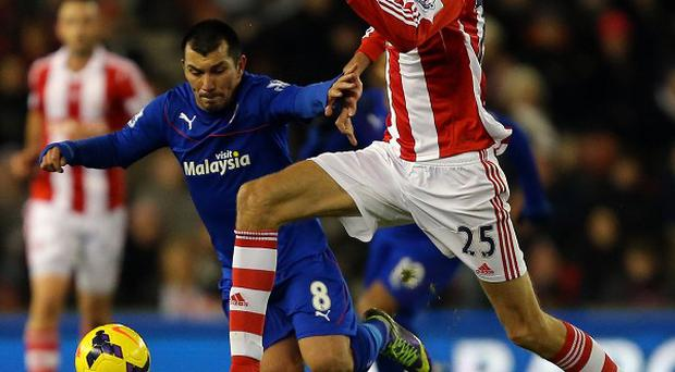 Peter Crouch, right, and Gary Medel challenge for the ball