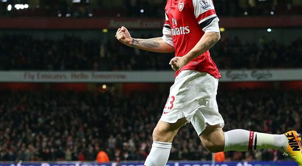 Arsenal's Nicklas Bendtner admits it has been difficult watching from the sidelines.