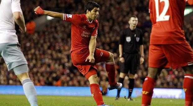 Luis Suarez fires home Liverpool's fourth goal