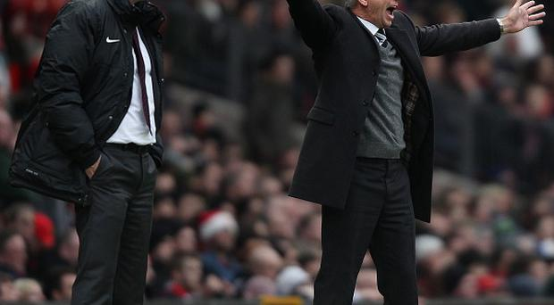 Alan Pardew, right, described David Moyes, left, as a 'strong man'