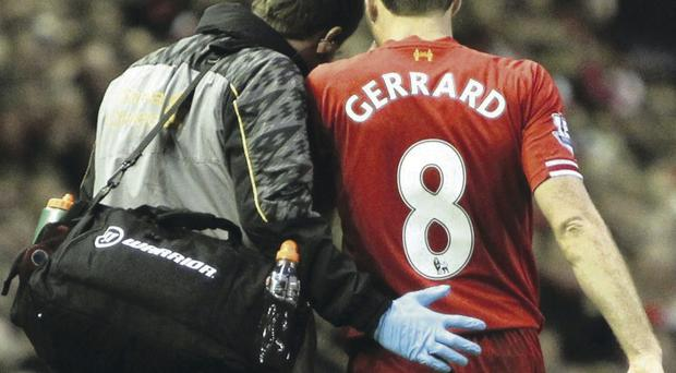 Injury scare: Steven Gerrard will need a scan after limping from the field minutes into the second-half at Anfield on Saturday