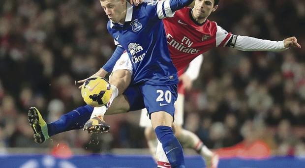 A great prospect: Everton's Ross Barkley challenges and takes the ball off Arsenal's Mikel Arteta during yesterday's match
