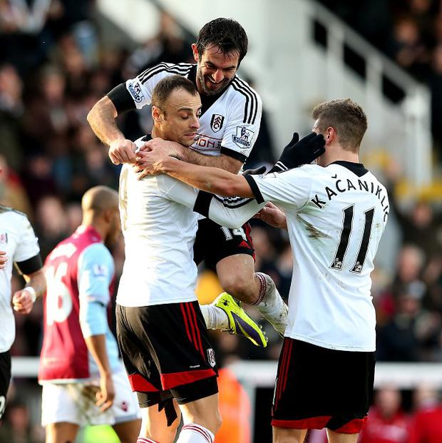 Dimitar Berbatov, centre, scored the second goal from the spot