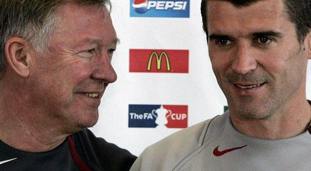 Roy Keane, right, has hit out at his former manager Sir Alex Ferguson, left