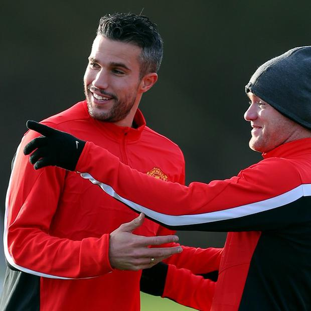 Robin Van Persie, left, believes the partnership between he and Wayne Rooney, right, will go from strength to strength