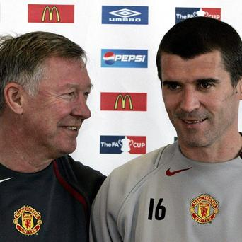 Roy Keane, right, has reopened his war of words with Sir Alex Ferguson, left