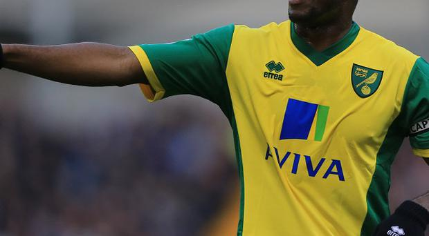 Norwich City captain Sebastien Bassong has signed a new deal with the club