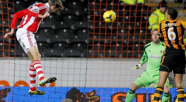 Peter Crouch, left, forces a fantastic save from Allan McGregor, right