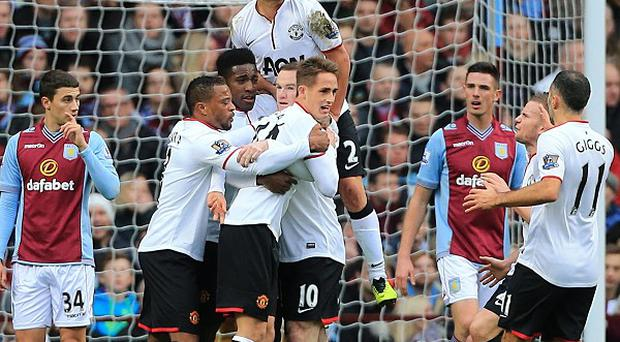 Danny Welbeck, centre left, celebrates scoring the opening goal