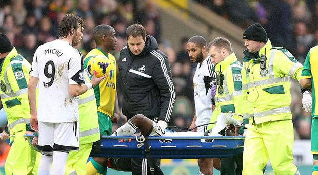 Nathan Dyer is carried off on a stretcher at Carrow Road