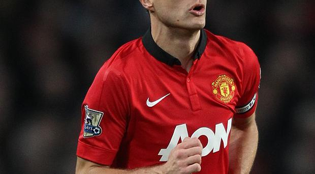 Nemanja Vidic faces a battle to regian his place in the Manchester United defence