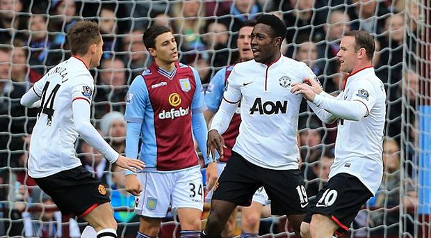 Danny Welbeck, centre, celebrates the first of his two goals against Aston Villa on Sunday
