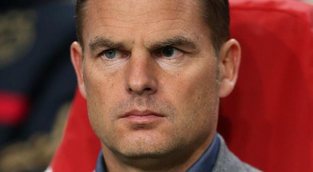 Frank de Boer has said he is fully focused on Ajax's fortunes, amid speculation he is up for the manager's job at White Hart Lane