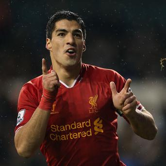 Brendan Rodgers said Luis Suarez has earned a shot at redemption